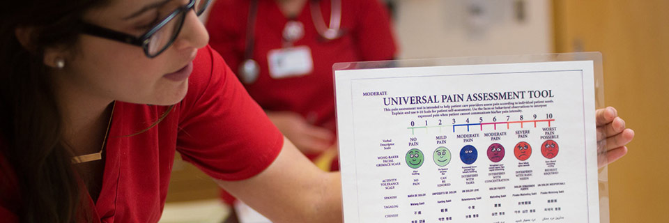 An IU nursing student uses the universal pain assessment tool.