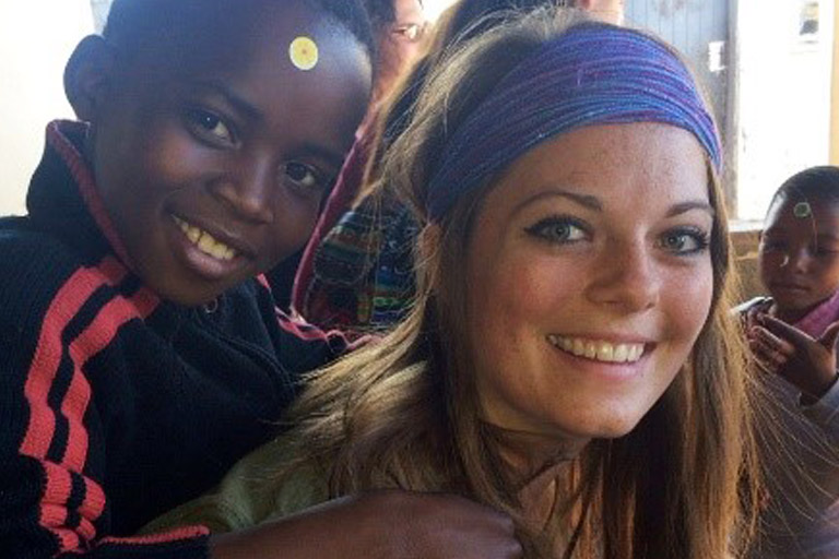 An IU nursing student poses with a child in Swaziland.