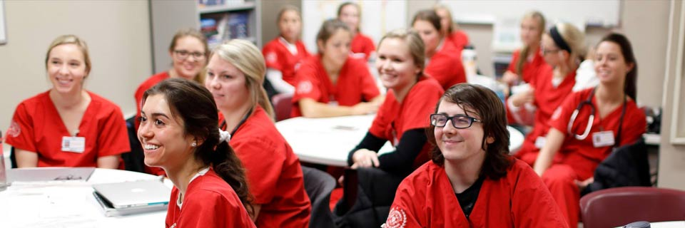 IU nursing students listen to a lecture in a classroom.